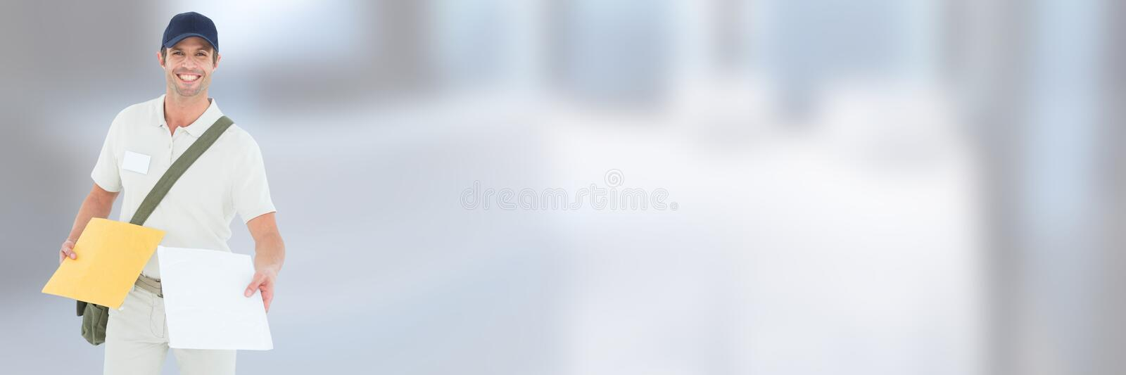 Delivery Courier holding form in front of blurred background stock photography