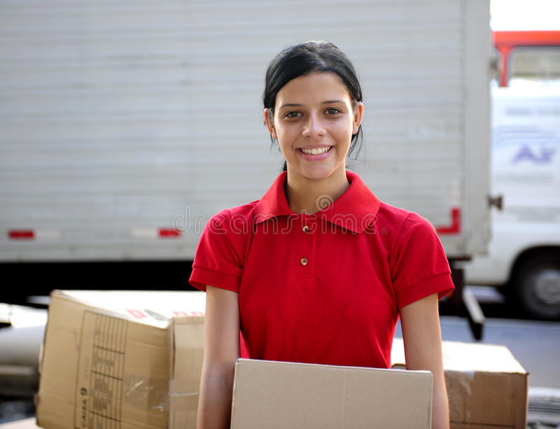 Download Delivery Courier Or Mover Delivering Cardboards Stock Photo - Image: 13632054