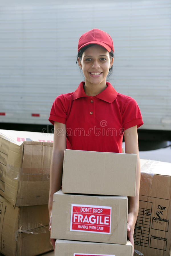 Download Delivery Courier Or Mover Delivering Cardboards Stock Images - Image: 13632114