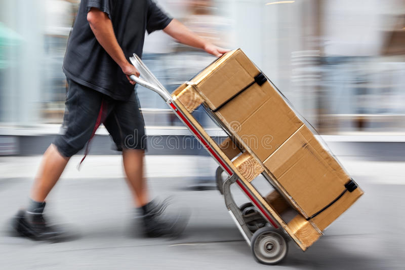Delivery with dolly by hand. Delivery goods with dolly by hand, purposely motion blur royalty free stock photography