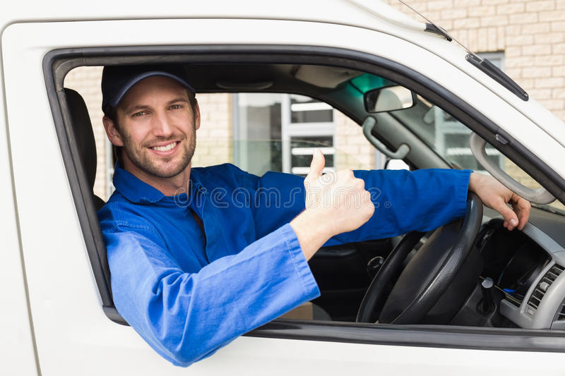 Delivery Driver Smiling At Camera In His Van Stock Image - Image of ...