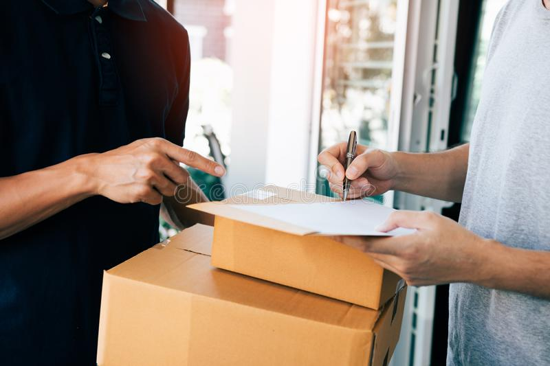 Delivery employee transport parcels pointing to documents for customers to receive products royalty free stock photos
