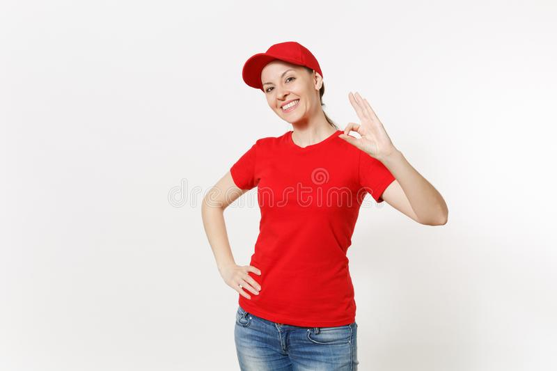 Delivery friendly woman in red uniform isolated on white background. Professional caucasian female in cap, t-shirt. Jeans working as courier or dealer, showing stock photos
