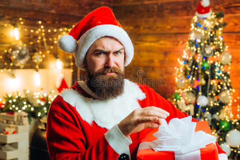 Delivery gifts. Gift emotions. Santa man holding gift. Design Gift Handmade. royalty free stock photos