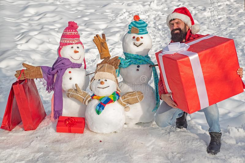 Delivery gifts. Happy winter snowman family. Mother snow-woman, father snow-man and kid wishes merry Christmas and Happy royalty free stock photos