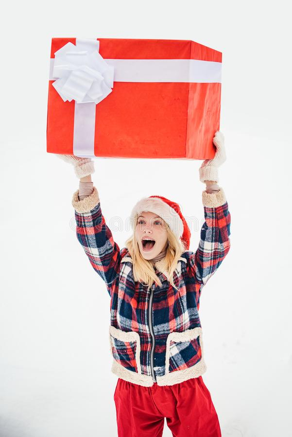 Delivery girl with winter gift box. Love winter. Merry Christmas and Happy Holidays. Happy woman with present or gift stock images
