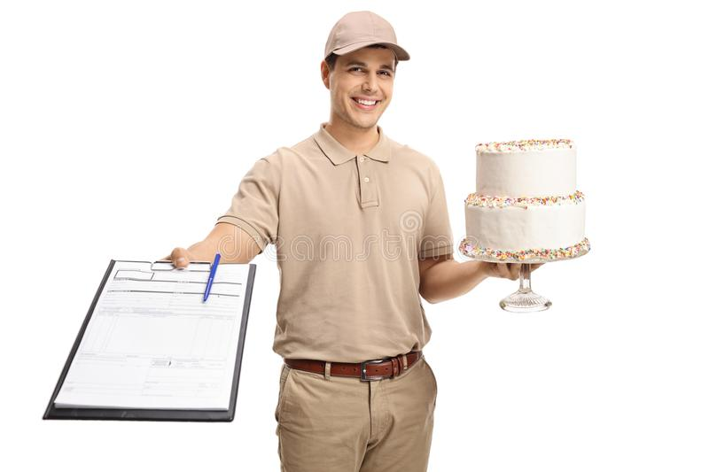 Delivery guy with a clipboard and a cake. Isolated on white background stock image