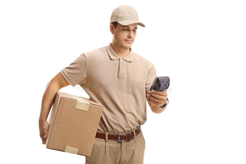 Delivery guy with a package and a payment terminal stock image