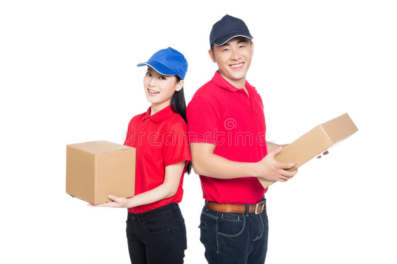 Delivery mailman carrying cardboard box. White background stock images