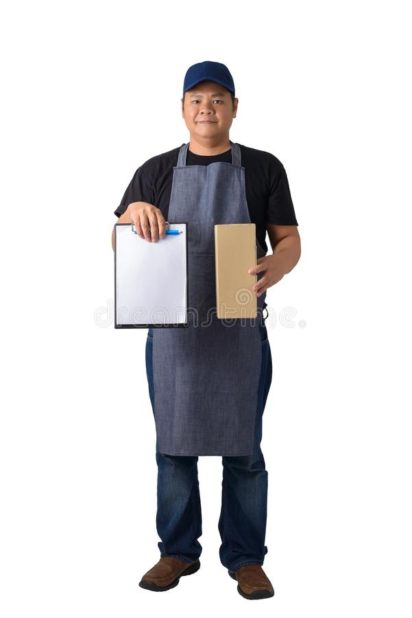 Delivery man in Black shirt and apron with stack of boxes is carrying parcel and presenting receiving form isolated. Full Body portrait of delivery man in Black stock photos