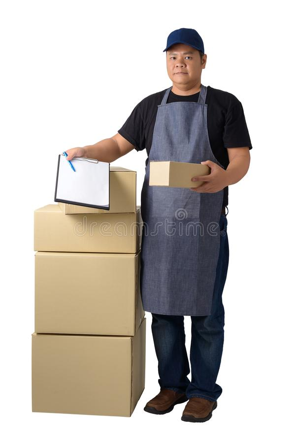 Delivery man in Black shirt and apron with stack of boxes is carrying parcel and presenting receiving form isolated. Full Body portrait of delivery man in Black stock image