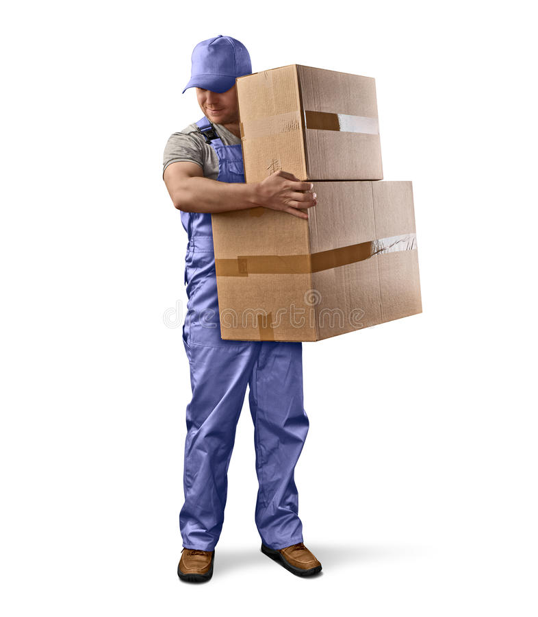 Delivery man in blue uniform holding a box royalty free stock photos