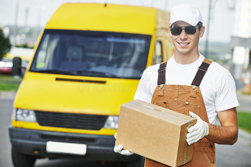 Delivery man with box stock images