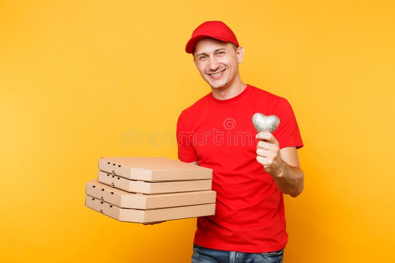 Delivery man in red cap t-shirt giving food order pizza boxes isolated on yellow background. Male employee pizzaman. Delivery man in cap t-shirt giving food stock photos