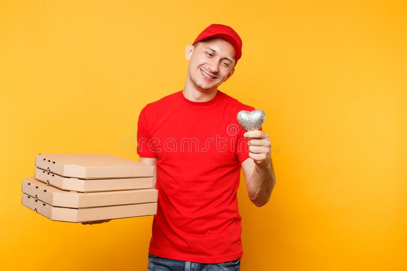 Delivery man in red cap t-shirt giving food order pizza boxes isolated on yellow background. Male employee pizzaman. Delivery man in cap t-shirt giving food stock photo