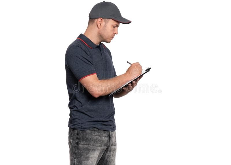 Delivery man in cap on white stock image