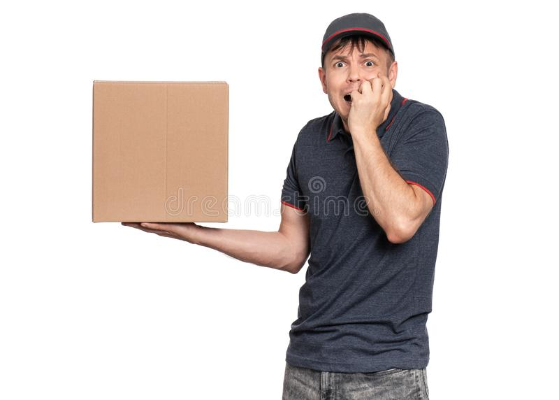 Delivery man in cap on white stock photography
