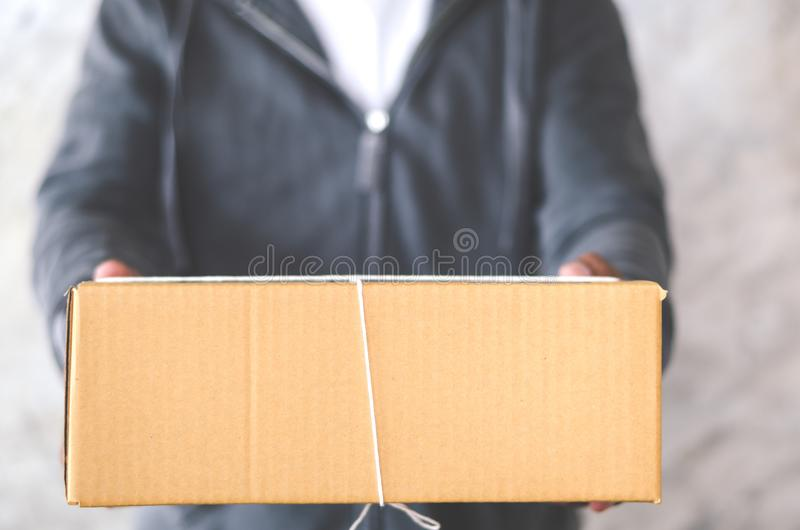 Delivery man carrying a parcel box royalty free stock photography