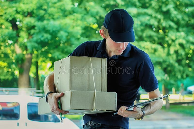 Delivery Man Delivering Package Box To Homeowner. Delivery Man Delivering Package To Homeowner. Anonymous box concept royalty free stock photos