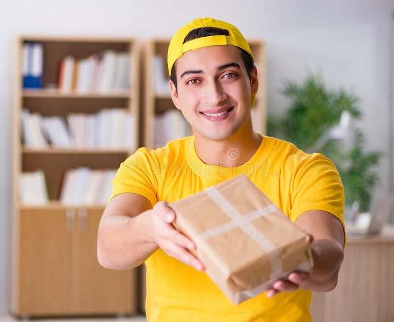 Delivery man delivering parcel box royalty free stock photo