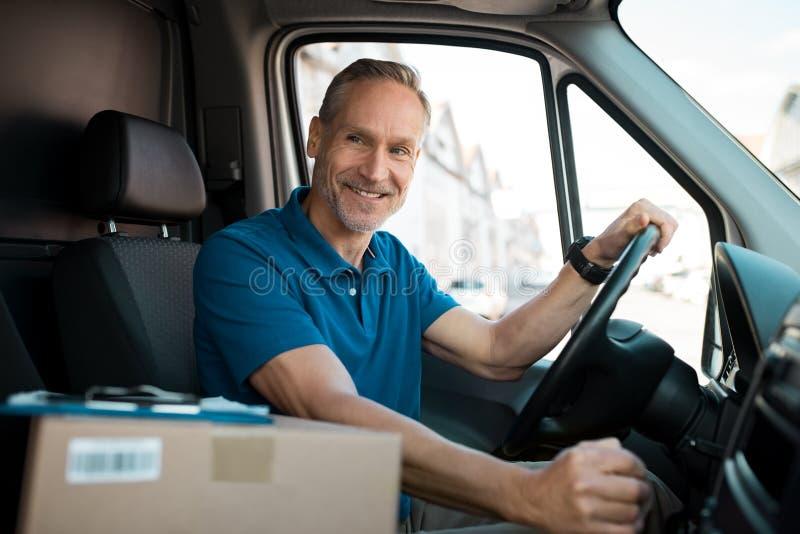 Delivery man driving van stock photos