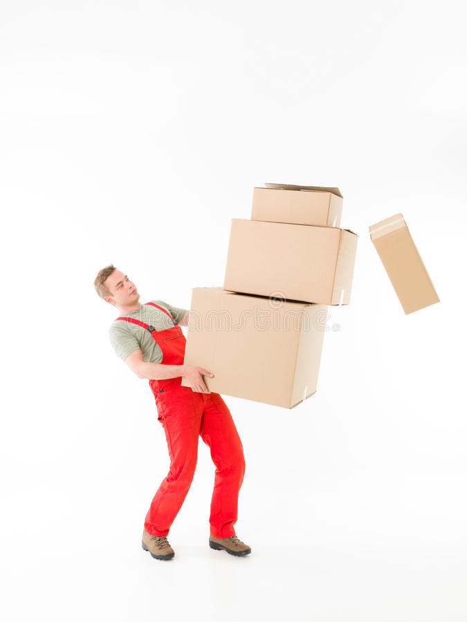 Delivery man dropping parcels royalty free stock photos