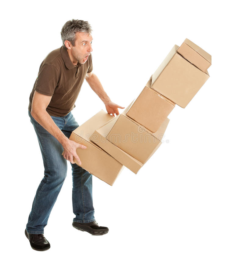 Delivery man with falling stack of boxes royalty free stock photos