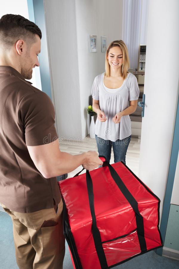 Delivery Man Giving Bag To Woman royalty free stock images