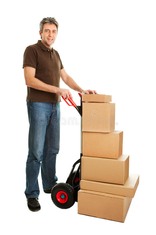 Delivery man with hand truck and stack of boxes stock photography