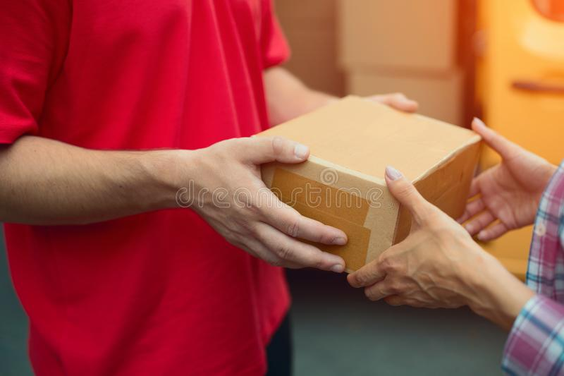 Delivery man handing package box. royalty free stock photo