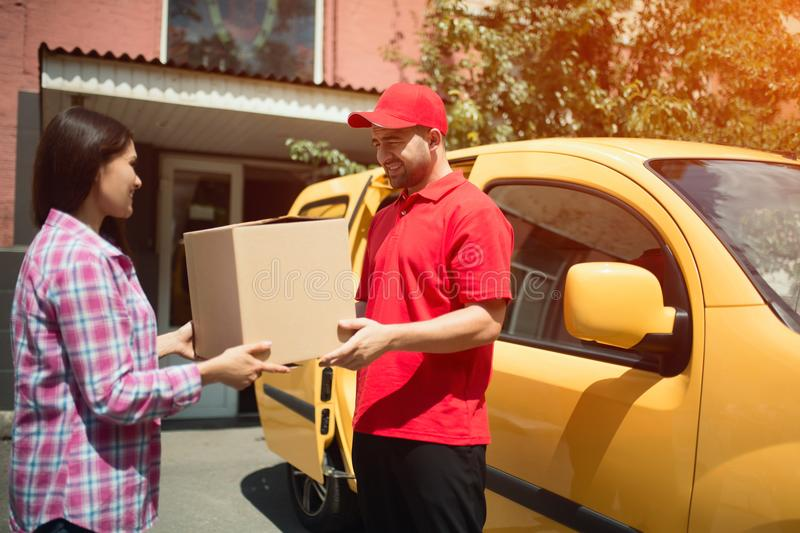 Delivery man handing package box. stock photography