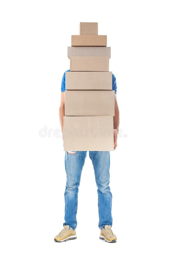 Delivery man hiding behind large stack of cardboard boxes stock photography