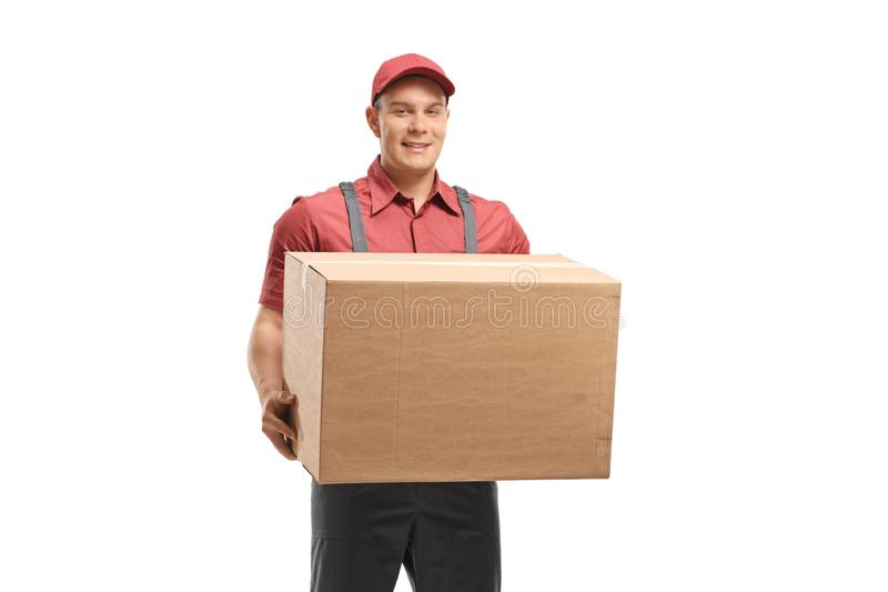 Delivery man holding a cardboard box stock images