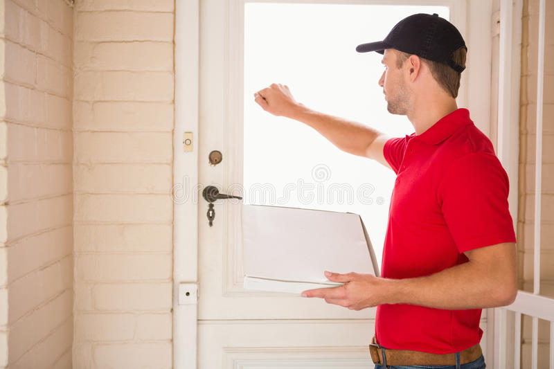 Download Delivery Man Holding Pizza While Knocking On The Door Stock Image - Image of pile & Delivery Man Holding Pizza While Knocking On The Door Stock Image ...