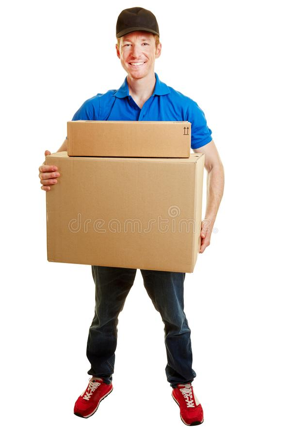 Delivery man making a parcel delivery royalty free stock image