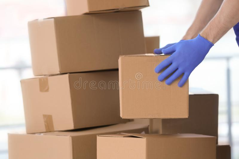Delivery man moving boxes stock image