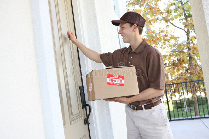 Download Delivery Man with Package stock image. Image of house - 7495985