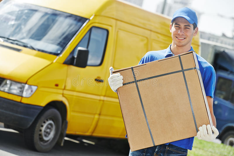 Delivery man with package outdoors stock photo