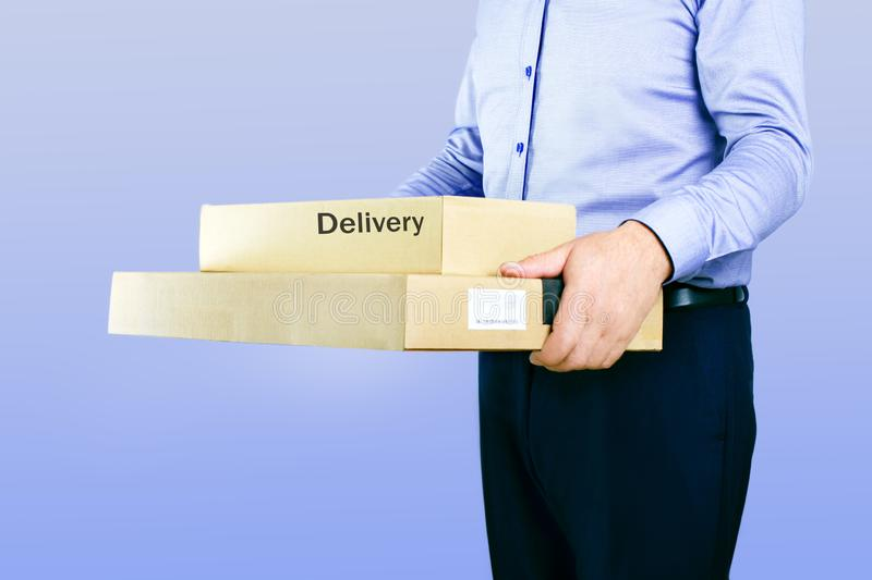 Delivery man with parcel or box. royalty free stock image