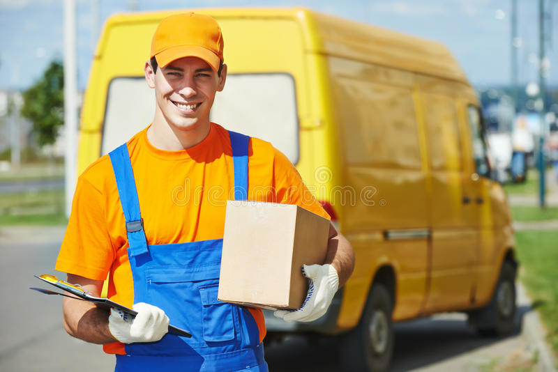 Delivery man with parcel box stock photography