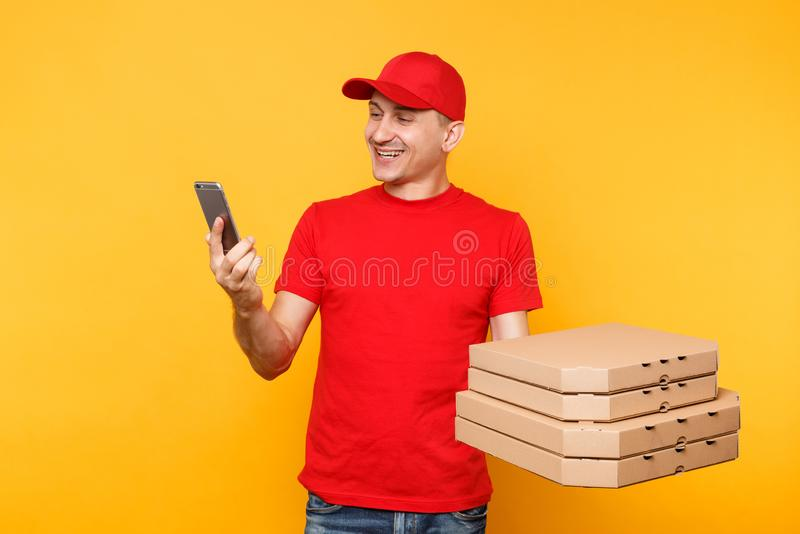 Delivery man in red cap t-shirt giving food order italian pizza in empty flatbox boxes on yellow background. Male. Employee pizzaman courier doing taking selfie royalty free stock photos