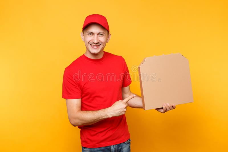 Delivery man in red cap, t-shirt giving food order pizza boxes isolated on yellow background. Male employee pizzaman. Courier holding pizza in empty blank royalty free stock photo