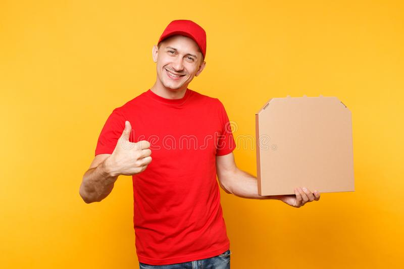 Delivery man in red cap, t-shirt giving food order pizza boxes isolated on yellow background. Male employee pizzaman. Courier holding pizza in empty blank royalty free stock image