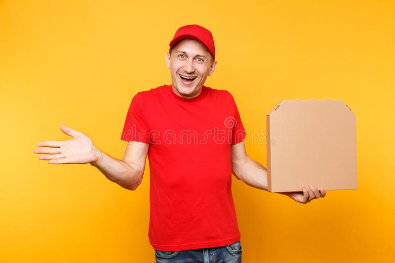 Delivery man in red cap, t-shirt giving food order pizza boxes isolated on yellow background. Male employee pizzaman. Courier holding pizza in empty blank royalty free stock photography