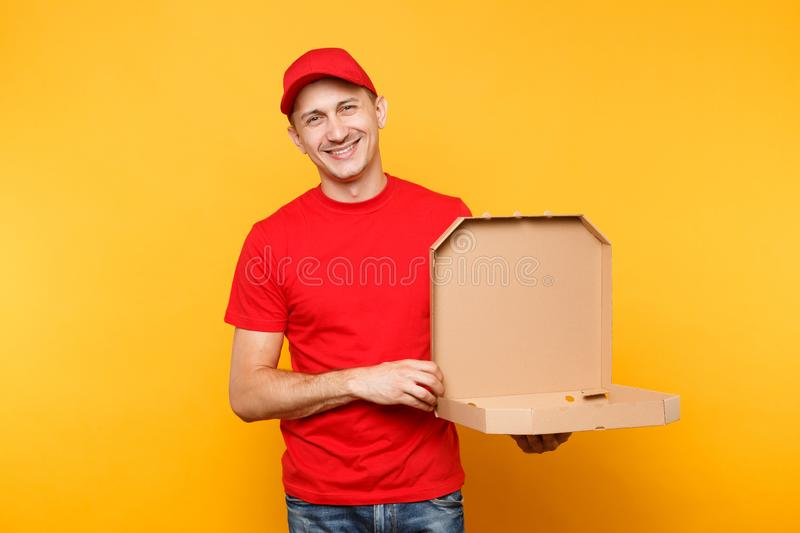 Delivery man in red cap, t-shirt giving food order pizza boxes isolated on yellow background. Male employee pizzaman or. Courier in uniform holding italian stock photo
