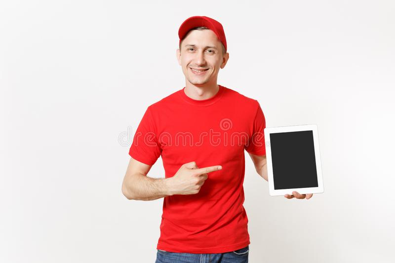 Delivery man in red uniform isolated on white background. Male in cap, t-shirt, jeans working as courier or dealer. Holding tablet pc computer with blank empty royalty free stock images