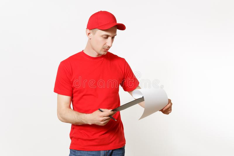 Delivery man in red uniform isolated on white background. Male in cap, t-shirt working as courier or dealer, holding pen. Clipboard with papers, filling royalty free stock photos