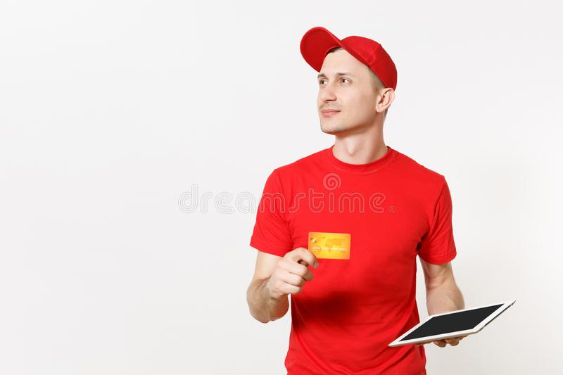 Delivery man in red uniform isolated on white background. Male in cap, t-shirt working as courier or dealer, holding. Tablet pc computer with blank empty screen stock photography