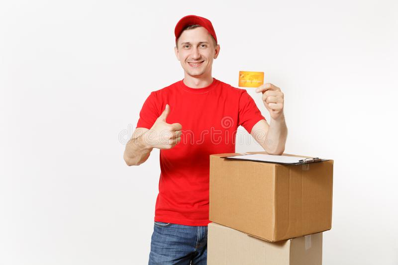 Delivery man in red uniform isolated on white background. Male courier in cap holding credit card, pen, clipboard with royalty free stock photography