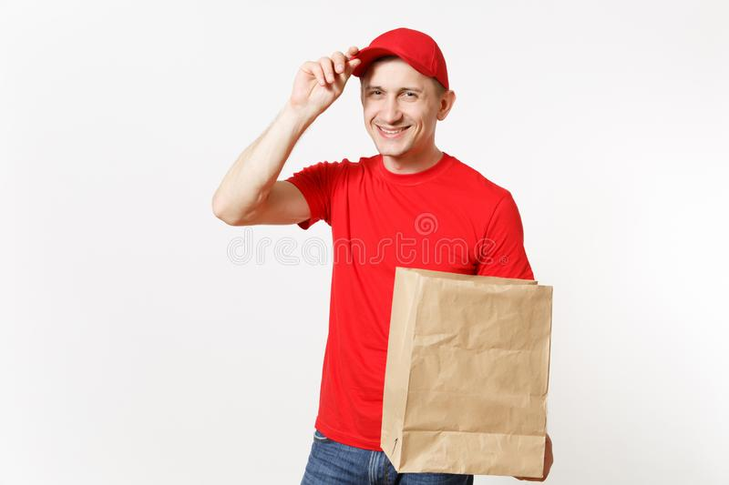 Delivery man in red uniform isolated on white background. Male courier in cap, t-shirt holding empty blank paper packet. For food. Products delivery from shop stock photos